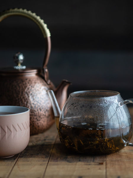 The Sichuan teahouses historically offered tea in distinctive a red copper teapots to pour into a gaiwan of fine Jingdezhen porcelain.